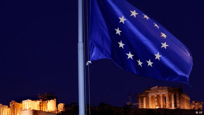 The EU flag flutters in the wind with the ancient Parthenon temple
