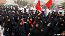 Anti-government protesters are seen marching on a highway leading to the village of Karzakan during a rally held by Bahrain's main opposition party Al Wefaq south of Manama, May 11, 2012. REUTERS/Hamad I Mohammed (BAHRAIN - Tags: CIVIL UNREST POLITICS)