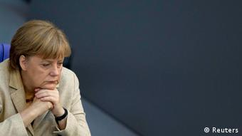 German Chancellor Angela Merkel attends a debate after delivering a statement on her government policies ahead of the upcoming G8 and NATO summits in the German lower house of parliament, the Bundestag, in Berlin, May 10, 2012. Merkel rejected calls from her centre-left opponents in Germany and Europe for economic stimulus policies that rely on new debt, warning parliament on Thursday that growth on credit would just tip Europe deeper into crisis. Since the election of Socialist Francois Hollande as French president on Sunday, Merkel has come under pressure to relax the austerity measures that, as leader of Europe's biggest economy, she has prescribed as the remedy for the euro zone debt crisis. REUTERS/Thomas Peter (GERMANY - Tags: POLITICS HEADSHOT)