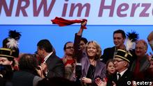 Hannelore Kraft, federal state premier of Germany's most populous state North-Rhine Westphalia waves with a shirt at an election campaign in Bochum May 11, 2012. Kraft is the top candidate of the Social Democratic Party (SPD) in the May 13 federal state election in North-Rhine Westphalia. REUTERS/Ina Fassbender (GERMANY - Tags: POLITICS ELECTIONS)