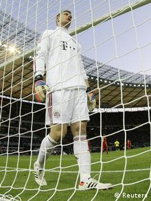 Bayern Munich's goalkeeper Manuel Neuer reacts after a third goal was scored by Borussia Dortmund during the German DFB Cup (DFB Pokal) final soccer match at the Olympic stadium in Berlin May 12, 2012. REUTERS/Michael Dalder (GERMANY - Tags: SPORT SOCCER TPX IMAGES OF THE DAY) DFB RULES PROHIBIT USE IN MMS SERVICES VIA HANDHELD DEVICES UNTIL TWO HOURS AFTER A MATCH AND ANY USAGE ON INTERNET OR ONLINE MEDIA SIMULATING VIDEO FOOTAGE DURING THE MATCH