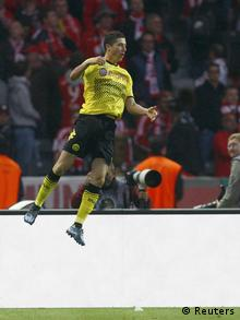 Borussia Dortmund's Robert Lewandowski celebrates third goal against Bayern Munich during their German DFB Cup (DFB Pokal) final soccer match at the Olympic stadium in Berlin, May 12, 2012. REUTERS/Thomas Bohlen (GERMANY - Tags: SPORT SOCCER) DFB RULES PROHIBIT USE IN MMS SERVICES VIA HANDHELD DEVICES UNTIL TWO HOURS AFTER A MATCH AND ANY USAGE ON INTERNET OR ONLINE MEDIA SIMULATING VIDEO FOOTAGE DURING THE MATCH