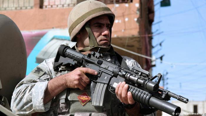 epa03217055 (FILE) A file photograph dated 12 February 2012, shows a Lebanese soldier standing guard in a military vehicles in Bab al-Tabbaneh neighborhood in Tripoli, northern Lebanon. According to media reports on 13 May 2012, two people were killed in armed clashes in northern Lebanon between loyalists of Syrian President Bashar al-Assad and local opponents. The clashes raged in the port city of Tripoli between residents of the neighbourhood of Jabal Mohsen mainly populated by Alawites, an offshoot of Shiite Islam to which al-Assad belongs, and rivals from the Sunni Muslim_dominated district of Bab al-Tabbaneh. Rocket-propelled grenades and gunfire were used, which prompted an intervention from the Lebanese army. One of the deaths was a soldier killed by sniper fire, reported Lebanon_s state news agency. EPA/ADEL KARROUM +++(c) dpa - Bildfunk+++