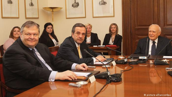 esident of Republic Karolos Papoulias (R) meets with political leaders.