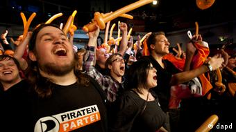 Pirate party supporters celebrate their election result in Düsseldorf
