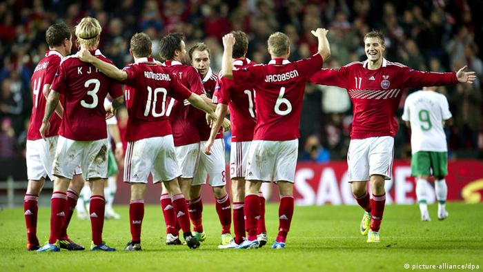Danish players celebrate after defeating Portugal 2 -1 in the group H EURO 2012 qualifying match