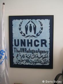 UNHCR sign in Amman