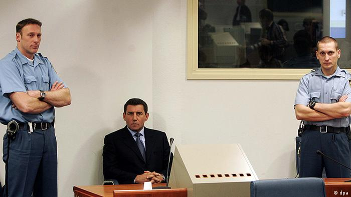 Former Croatian General Ante Gotovina, center, is seen during his initial appearance at the courtroom of the Yugoslav war crimes tribunal in The Hague, the Netherlands, Monday Dec. 12, 2005. Gotovina is indicted on seven counts of crimes against humanity for the killings of at least 150 Serbs by troops under his command, the expulsion of tens of thousands of others and the destruction and pillaging of at least 11 Serb villages during the closing months of the Croatian war in 1995. Gotovina was third on the tribunal's most wanted list, preceded only by Bosnian Serb leader Radovan Karadzic and his top commander Ratko Mladic. (ddp images/AP Photo/Ed Oudenaarden, Pool))
