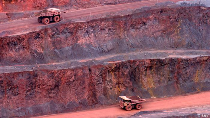Trucks make their way loaded with iron ore at the mine of Companhia Vale do Rio Doce in Carajas, northern state of Para, Brazil, on May 3, 2004. (Photo: ddp images/AP Photo/ Andre Penner)