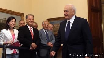 Greek president Karolos Papoulias arrives for a meeting with three of the Greek political leaders in Athens