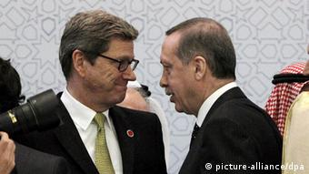 epa02989318 Polish Foreign Minister Radoslaw Sikorski (L) and German Foregin Minister Guido Westerwelle walk after a family photo session at Istanbul Conference for Afghanistan Summit in Istanbul, Turkey 02 November 2011. Leaders of 26 countries gathered in Istanbul on 02 November to lay the groundwork for a conference next month, where world leaders will discuss the future of a post-NATO Afghanistan. EPA/TOLGA BOZOGLU