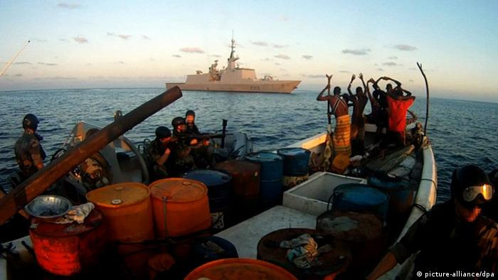 A group of suspected pirates is taken into custody by the crew of an EU warship