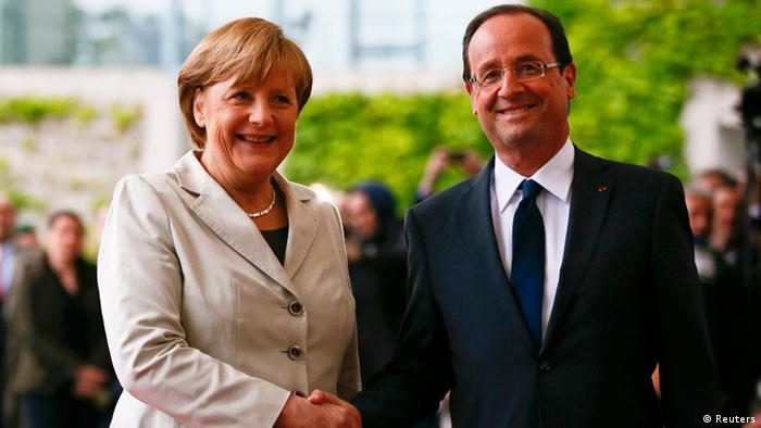 German Chancellor Angela Merkel welcomes French President Francois Hollande at the Chancellery in Berlin, May 15, 2012. Hollande called for a European pact for growth to balance out German-driven austerity measures in his inaugural address on Tuesday, hours before taking his challenge to Chancellor Angela Merkel in Berlin. Sworn in with all the pomp of the French Republic, Hollande won support from Germany's opposition Social Democrats (SPD), who vowed to use their parliamentary blocking power to delay ratifying a European budget discipline treaty until Merkel accepts accompanying measures to boost growth and jobs. REUTERS/Fabrizio Bensch (GERMANY - Tags: POLITICS)