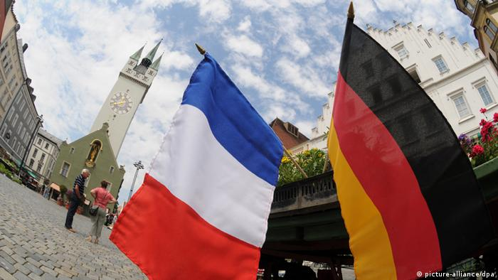 French and German flags hang side-by-side
