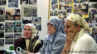 Women of the 'Mothers of Srebrenica at a table
