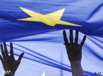 Hands seen holding up the EU flag