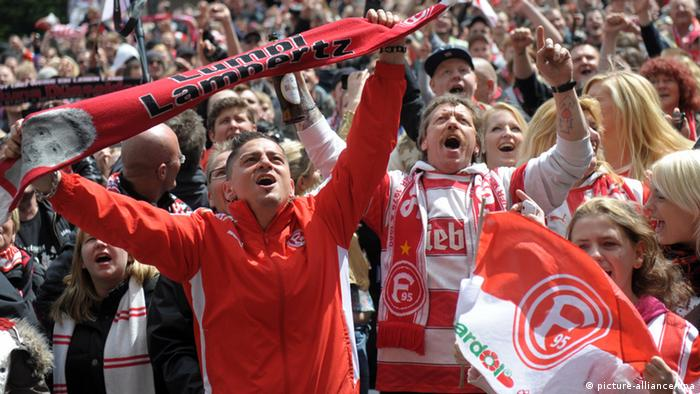 Dusseldorf fans celebrate the team's promotion