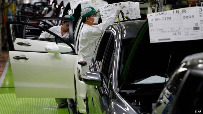 Workers give the final checkup on the cars of Honda Accord Tourer
