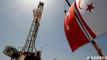 Turkish and Turkish Cypriot flags wave next to a drilling tower 25 km (16 miles) from Famagusta April 26, 2012. Turkish Cypriot Leader Dervis Eroglu and Turkey's Energy Minister Taner Yildiz attended a ceremony marking the start of joint gas and oil exploration works in northern Cyprus between Turkey's state-owned energy company TPAO and the Turkish-Cypriot administration. REUTERS/Umit Bektas (TURKEY - Tags: POLITICS ENERGY BUSINESS)