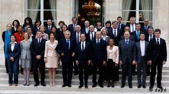 French President Francois Hollande, center, poses with his ministers after the first weekly cabinet meeting