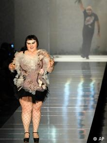 US singer Beth Ditto is joined on stage by Jean-Paul Gaultier (AP)