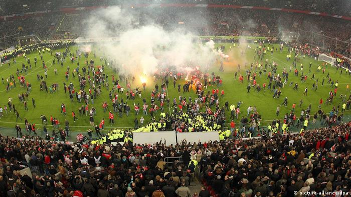 Police clear the pitch of invading supporters at Tuesday's Hertha Berlin, Fortuna Dusseldorf match.