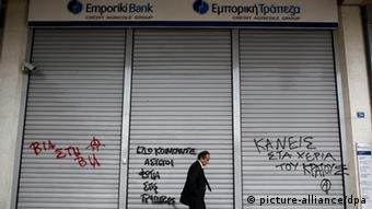 epa03222642 A man walks in front a closed bank branch in Athens, Greece, 17 May 2012. Reports state that the Bank of Greece Governor George Provopoulos warned this week that people_s concerns about the economy could turn to panic. EPA/ALKIS KONSTANTINIDIS