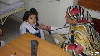A nurse treats a young female student