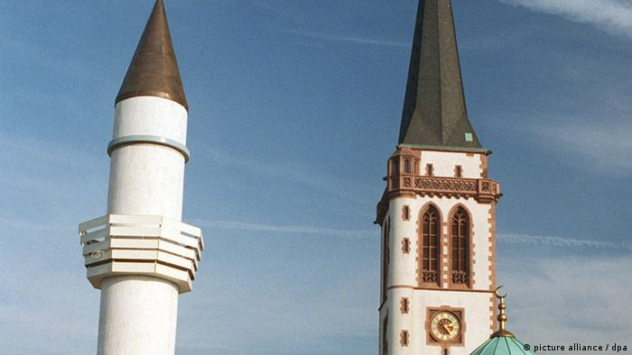 A minaret and a church tower stand side by side