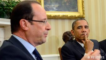 U.S. President Barack Obama (R) listens as French President Francois Hollande speaks following their bilateral meeting in the Oval Office of the White House in Washington May 18, 2012. Hollande is in the United States to join other leaders of the major industrial economies and meet for a G8 Summit at Camp David this weekend to try to head off a full-blown financial crisis in Europe. REUTERS//Eric Feferberg/Pool(UNITED STATES - Tags: POLITICS BUSINESS)