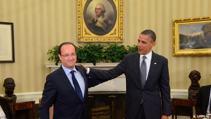 U.S. President Barack Obama (R) shakes hands with French President Francois Hollande as they meet in the Oval Office at the White House in Washington May 18, 2012. (Photo:REUTERS/Eric Feferberg/Pool )