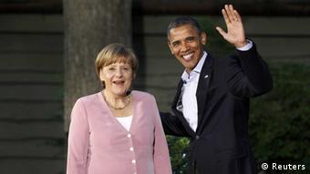 Angela Merkel smiles at the camera next to a waving Barack Obama. (Photo: eingestellt von qu)