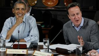President Barack Obama, left, listens to British Prime Minister David Cameron during the first meeting of the G8 summit