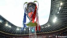 The UEFA Champions League trophy is pictured before the start of the Champions League final soccer match between Chelsea and Bayern Munich at the Allianz Arena in Munich, May 19, 2012. REUTERS/Dylan Martinez (GERMANY - Tags: SPORT SOCCER)