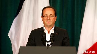 France's President Francois Hollande delivers a speech at the G8 summit in Camp David, May 19, 2012