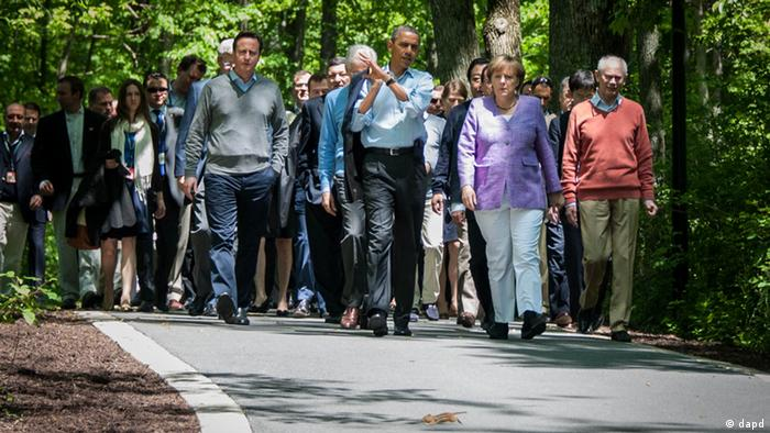 Merkel and Obama walking with other leaders in tow at Camp David