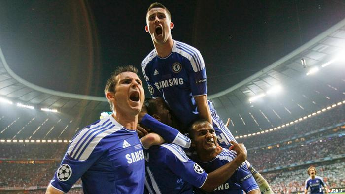 Chelsea's Didier Drogba (C) celebrates with team mates after scoring a goal against Bayern Munich.
