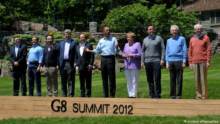 Leaders attend the family photo session at the G8 summit at Camp David, Maryland May 19, 2012.