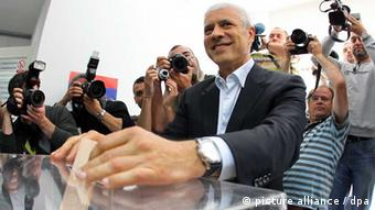Boris Tadic, leader of the Democratic Party (DS), casts his ballot