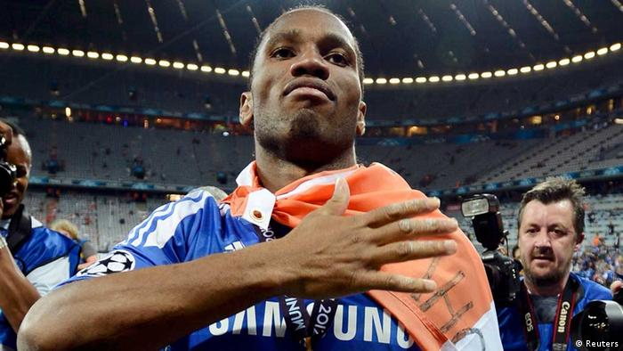Didier Drogba of Chelsea celebrate after his team's Champions League final soccer match against Bayern Munich at the Allianz Arena in Munich, May 19, 2012. REUTERS/Dylan Martinez (GERMANY - Tags: SPORT SOCCER)