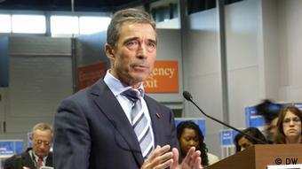 NATO Secretary General Rasmussen at a podium