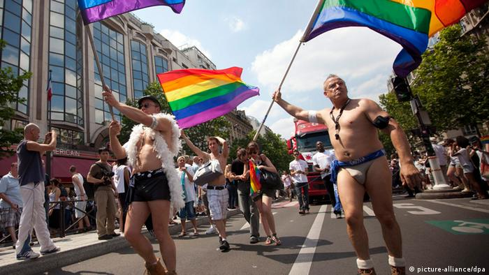 Participants wave rainbow flags during the annual Gay Pride parade in Paris, France, in June 2010. EPA/IAN LANGSDON