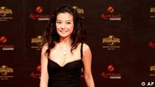 Chinese actress Vicky Zhao Wei walks on the red carpet during the grand opening of Universal Studios Singapore Friday, May 27, 2011. (AP Photo/Wong Maye-E)