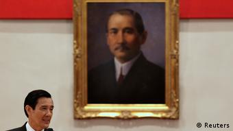 Taiwan President Ma Ying-jeou answers a question in front of a portrait of the founding father of the Republic of China, Dr. Sun Yat-sen during a news conference after his inauguration ceremony at the Presidential Office in Taipei May 20, 2012. Ma took office on Sunday for his second term. REUTERS/Pichi Chuang (TAIWAN - Tags: POLITICS)