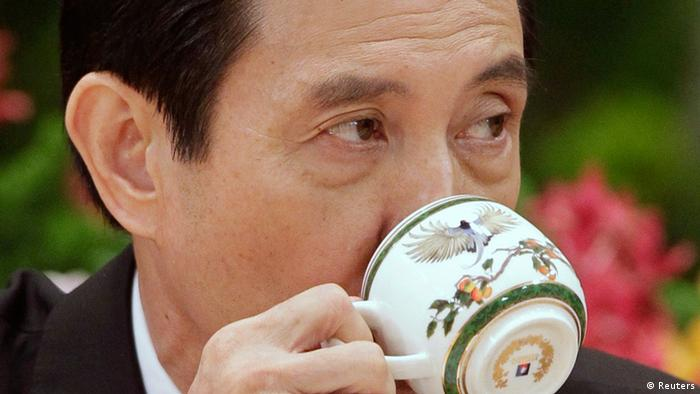 Taiwan President Ma Ying-jeou takes a sip from a cup during a news conference after his inauguration ceremony at the Presidential Office in Taipei May 20, 2012. Ma took office on Sunday for his second term. REUTERS/Pichi Chuang (TAIWAN - Tags: POLITICS)