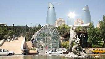 A fountain and the Flame Towers in Baku