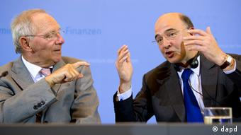 Schäuble, pictured next to Moscovici