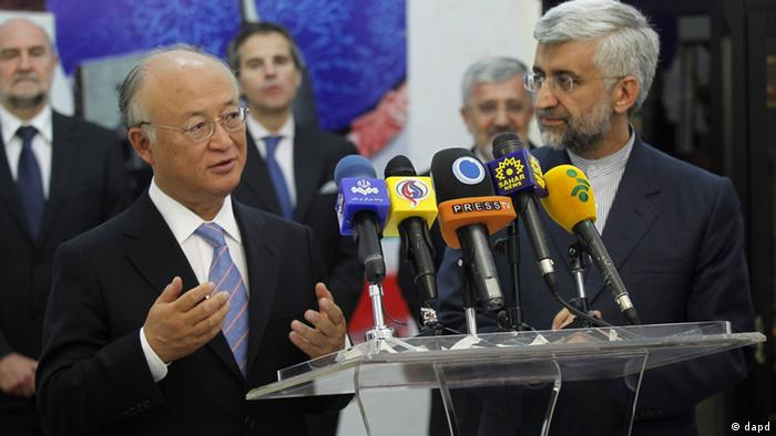 International Atomic Energy Agency (IAEA) chief Yukiya Amano, left, talks with reporters during a news briefing at the conclusion of his meeting with Iran's top nuclear negotiator, Saeed Jalili