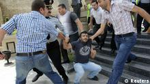 Plainclothes policemen detain an opposition supporter during an anti-government protest in central Baku May 21, 2012. REUTERS/David Mdzinarishvili (AZERBAIJAN - Tags: POLITICS CIVIL UNREST)