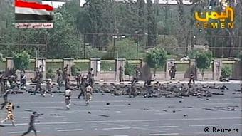 A still image taken from video shows army personnel running to the scene of a suicide attack in Sanaa May 21, 2012. A uniformed man blew himself up in the midst of a military parade rehearsal attended by senior officials in the Yemeni capital Sanaa on Monday, killing 63 soldiers, a police source said. REUTERS/Yemen TV via Reuters TV (YEMEN - Tags: POLITICS CIVIL UNREST CRIME LAW MILITARY) NO SALES. NO ARCHIVES. FOR EDITORIAL USE ONLY. NOT FOR SALE FOR MARKETING OR ADVERTISING CAMPAIGNS. THIS IMAGE HAS BEEN SUPPLIED BY A THIRD PARTY. IT IS DISTRIBUTED, EXACTLY AS RECEIVED BY REUTERS, AS A SERVICE TO CLIENTS. NO COMMERCIAL USE